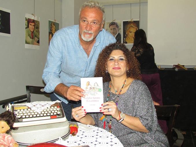 Zuhal Erol, SAGÜSAD Başkanı Ünal Dabak için kitabını imzaladı